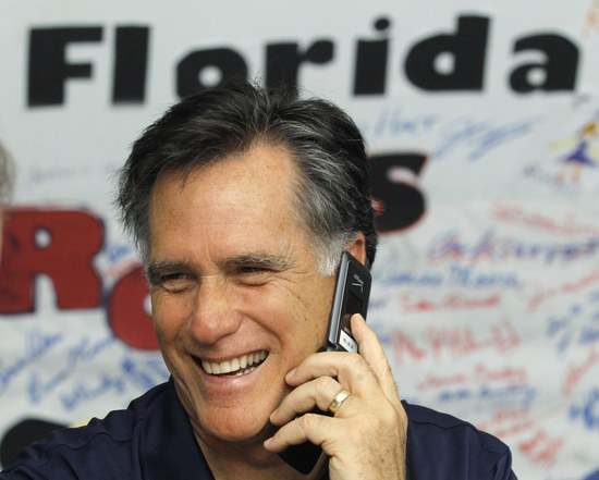 Mitt Romney with Florida sign behind him