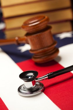 gavel and stethoscope on flag with law books