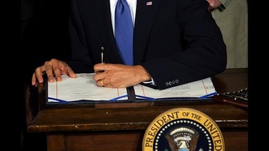 Obama signing ACA