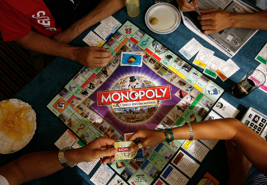 Players participate in a Guinness world record attempt taking place across the world for the largest simultaneous game of Monopoly, at a hotel in Madrid, August 27, 2008. Coinciding with the launch of the new Monopoly game