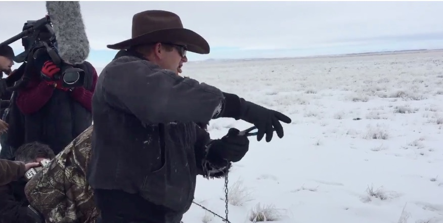 Ryan Bundy destroying a fence between federal land and private property