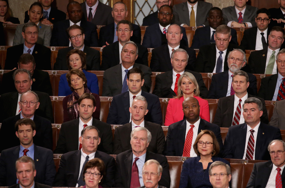 WASHINGTON, DC - JANUARY 12:  Members of congress including Republican presidential candidate Sen. Marco Rubio (R-FL) (C) listen to US President Barack Obama deliver the State of the Union speech in the House chamber of the U.S. Capitol January 12, 2016 i