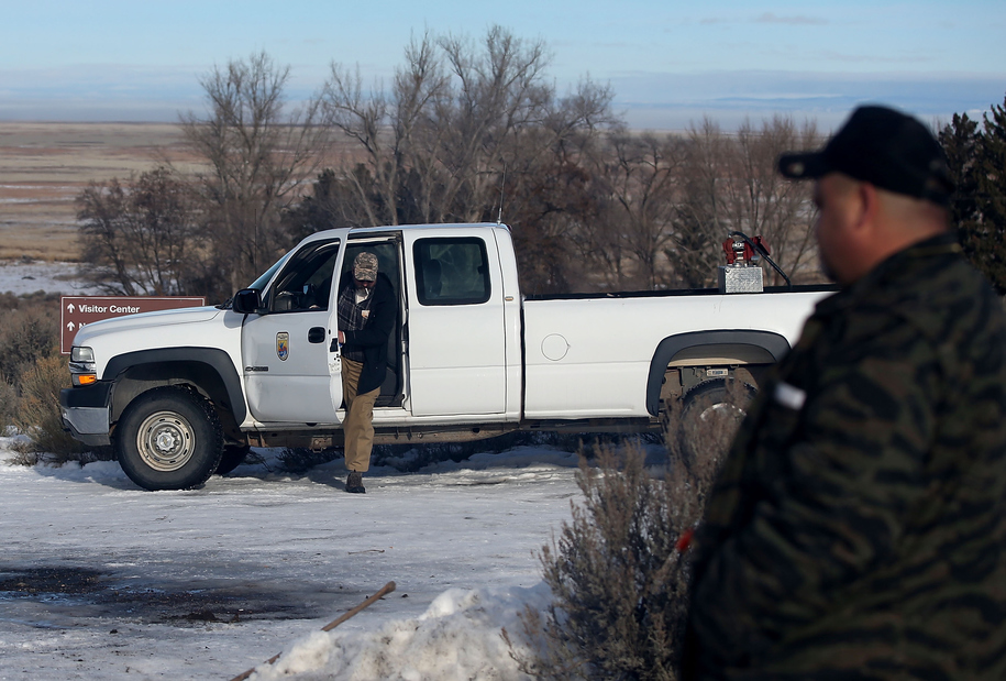 BURNS, OR - JANUARY 06:  A member of an anti-government militia steps out of a U.S. Fish and Wildlife vehicle at the Malheur National Wildlife Refuge Headquarters on January 6, 2016 near Burns, Oregon.  An armed anti-government militia group continues to