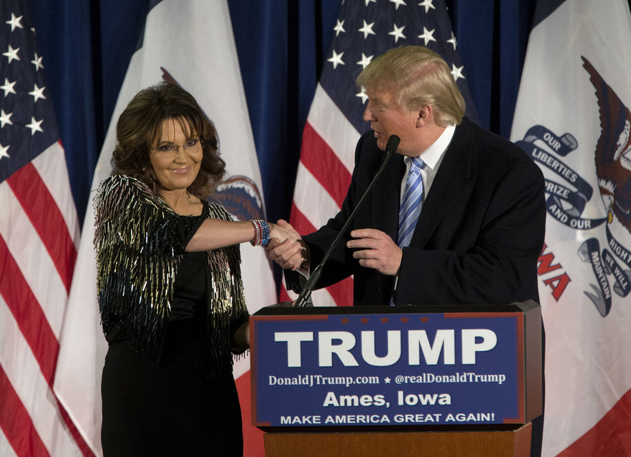 AMES, IA - JANUARY 19:   Republican presidential candidate Donald Trump shakes hands with former Alaska Gov. Sarah Palin at Hansen Agriculture Student Learning Center at Iowa State University on January 19, 2016 in Ames, IA. Trump received Palin's endorse