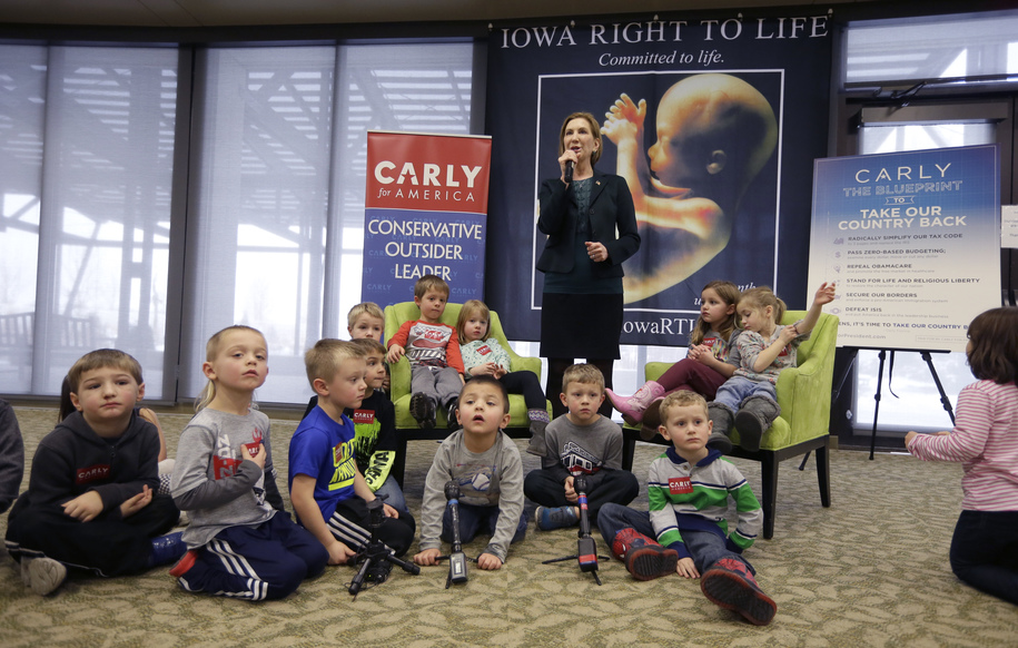 Republican presidential candidate Carly Fiorina is surrounded by preschool students as she speaks during the Iowa Right to Life Presidential Forum, Wednesday, Jan. 20, 2016, in Des Moines, Iowa. (AP Photo/Charlie Neibergall)