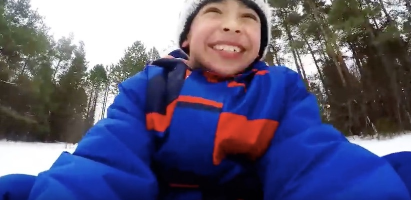 Syrian refugee children sledding for the first time