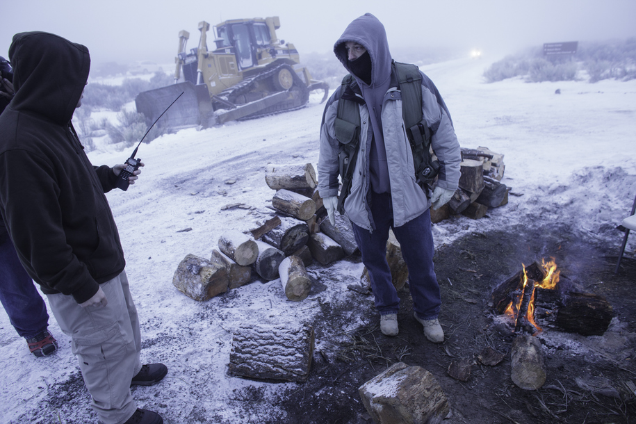 A group of men stay warm by a fire at the occupied Malheur National Wildlife Refuge on the sixth day of the occupation of the federal building in Burns, Oregon on January 7, 2016. The leader of a small group of armed activists who have occupied a remote w
