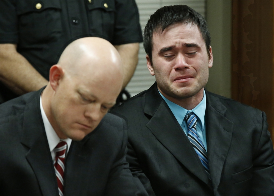 Daniel Holtzclaw, right, cries as the verdicts are read in his trial in Oklahoma City, Thursday, Dec. 10, 2015. At left is defense attorney Robert Gray. Holtzclaw, a former Oklahoma City police officer, was facing dozens of charges alleging he sexually as