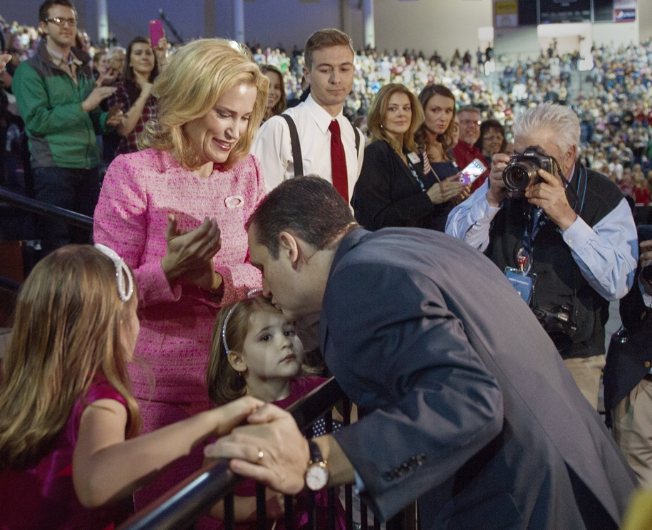 US Senator Ted Cruz(R-TX) greets his wife Heidi and daughters Caroline (R) and Catherine (C) before taking the stage announce his candidacy for the Republican nomination to run for US President March 23, 2015 at Liberty University in Lynchburg, Virginia.