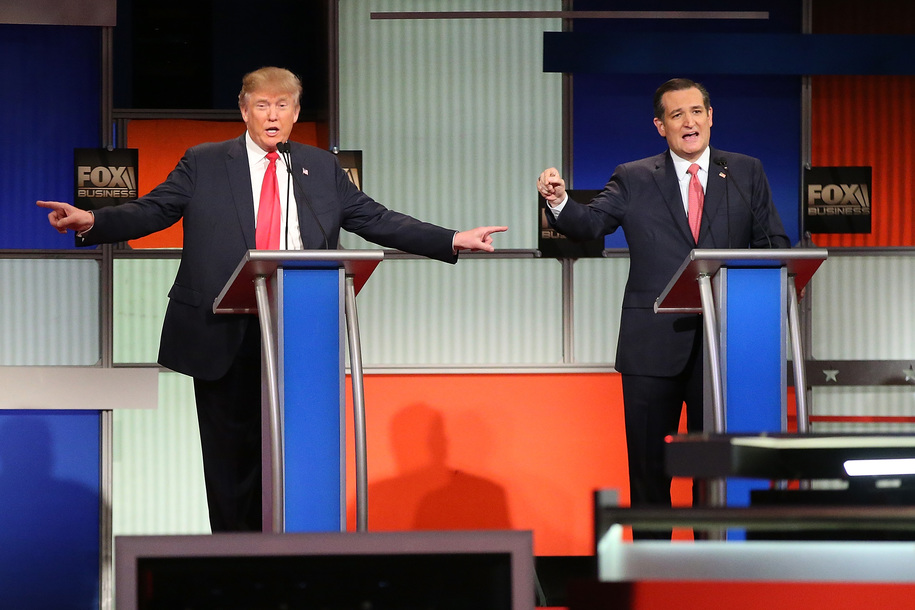 NORTH CHARLESTON, SC - JANUARY 14:  Republican presidential candidates (L-R) Donald Trump and Sen. Ted Cruz (R-TX) participate in the Fox Business Network Republican presidential debate at the North Charleston Coliseum and Performing Arts Center on Januar