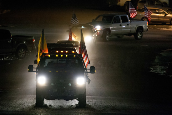 BURNS, OR  - JANUARY 30:  Anti-government protesters drive through town during a rally prior to a rolling vehicle protest by self-proclaimed patriots on January 30, 2016 in Burns, Oregon. Eight protestors who had been occupying the Malheur National Wildli