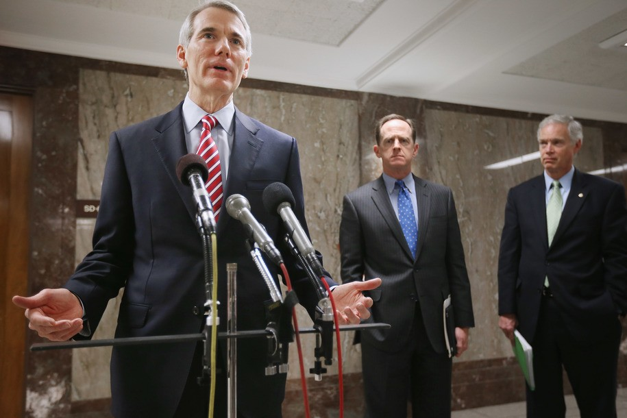 WASHINGTON, DC - MARCH 14:  Senate Budget Committee members (L-R) Sen. Rob Portman (R-OH), Sen. Pat Toomey (R-PA) and Sen. Ron Johnson (R-WI) make brief statements to the news media before the second day of markup hearings in the Dirksen Senate Office Bui