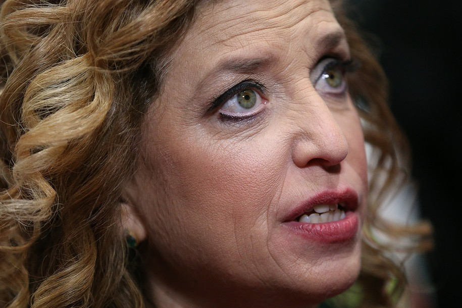 CHARLESTON, SC - JANUARY 17:  U.S. Representative Debbie Wasserman Schultz (D-FL 23rd District) and chair of the Democratic National Committee (DNC) speaks to reporters in the spin room after watching tonight's democratic presidential debate at the Gailla