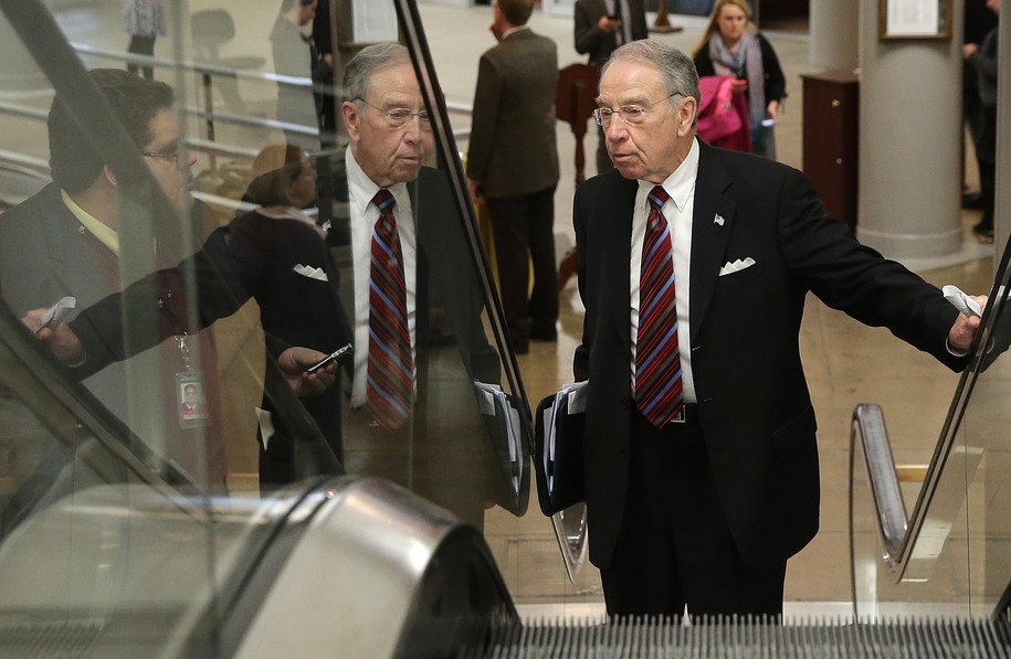 WASHINGTON, DC - MARCH 04: Sen. Chuck Grassley (R-IA)  answers questions from reporters as he walks to the Senate chamber to vote on an attempt to override U.S. President Barack Obama's veto of the Keystone XL Pipeline legislation March 4, 2015 in Washing