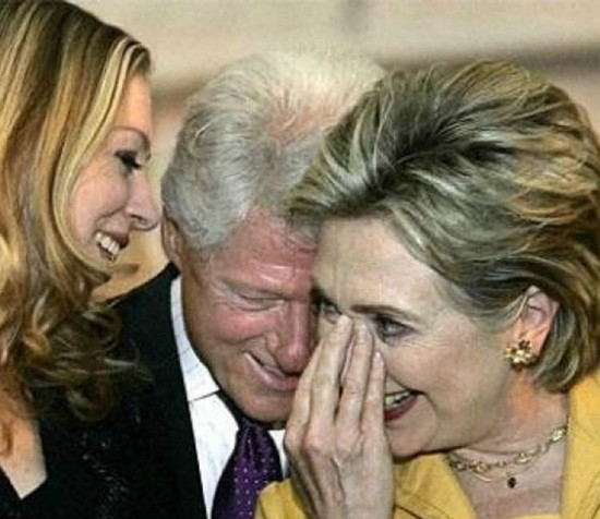 Bill Clinton, Hillary Clinton and Chelsea Clinton laughing