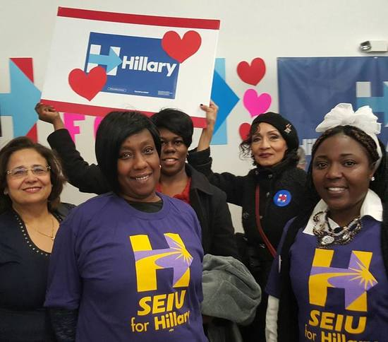 Five women (two in SEIU union t-shirts) in front of Hillary sign, Milwaukee, WI, Mar. 24, 2016