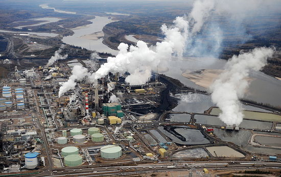 Aerial view of the Suncor oil sands extraction facility near the town of Fort McMurray in Alberta on October 23, 2009. Greenpeace are calling for an end to oil sands mining in the region due to their greenhouse gas emissions and have recently staged sit-ins which briefly halted production at several mines. At an estimated 175 billion barrels, Alberta's oil sands are the second largest oil reserve in the world behind Saudi Arabia, but they were neglected for years, except by local companies, because of high extraction costs. Since 2000, skyrocketing crude oil prices and improved extraction methods have made exploitation more economical, and have lured several multinational oil companies to mine the sands. AFP PHOTO/Mark RALSTON (Photo credit should read MARK RALSTON/AFP/Getty Images)