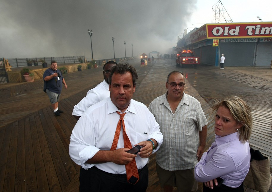 SEASIDE HEIGHTS, NJ - SEPTEMBER 12, 2013:  In this handout provided by the Office of the Governor Of N.J., Governor Chris Christie (L) tours the fire area with Deputy Chief of Staff Bridget Anne Kelly (R), senior staff and Office of Emergency Management personnel after a fire at the boardwalk September 12, 2013 in Seaside Heights, New Jersey. In an ongoing investigation in January, 2014, Christie Deputy Chief of Staff Bridget Anne Kelly was accused of giving a signal to the Port Authority of New York and New Jersey about  two weeks before two lanes of the George Washington Bridge, allegedly as punishment for the Fort Lee, New Jersey mayor not endorsing the Governor during the election. The Governor has since denied any approval or involvement in the allegations and has fired the aide. (Photo by Tim Larsen/Office of the Governor Of N.J. via Getty Images)