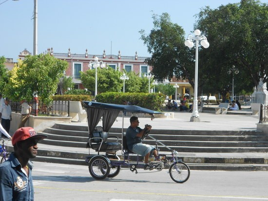 Bicycle taxi in front of Calixto Garcia Park, Holguin, Cuba