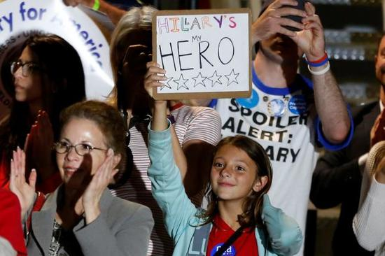 "Clinton supporters cheering at union hall Commerce, CA, May 24, 2016, with sign ""Hillary"