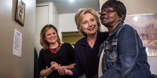 MANHATTAN, NY - Former Secretary of State Hillary Clinton meets resident Allie Eason, right, and tours apartments for Latino seniors at Corsi House in the Spanish Harlem neighborhood in Manhattan, New York on Friday April 15, 2016. And accompanied by Speaker of the New York City Council Melissa Viverito, left. (Photo by Melina Mara/The Washington Post via Getty Images)