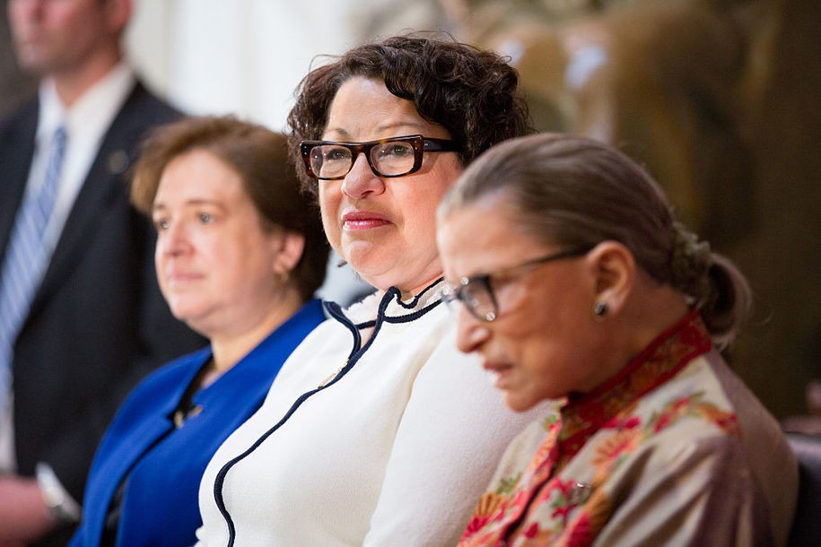 WASHINGTON, DC - MARCH 18: (L-R) U.S. Supreme Court justices Elena Kagan, Sonia Sotomayor and Ruth Bader Ginsburg, participate in an annual Women's History Month reception hosted by Democratic House Leader Nancy Pelosi in the U.S. capitol building on Capitol Hill in Washington, D.C.  This year's event honored the women Justices of the U.S. Supreme Court: Associate Justices Ruth Bader Ginsburg, Sonia Sotomayor, and Elena Kagan. (Photo by Allison Shelley/Getty Images)