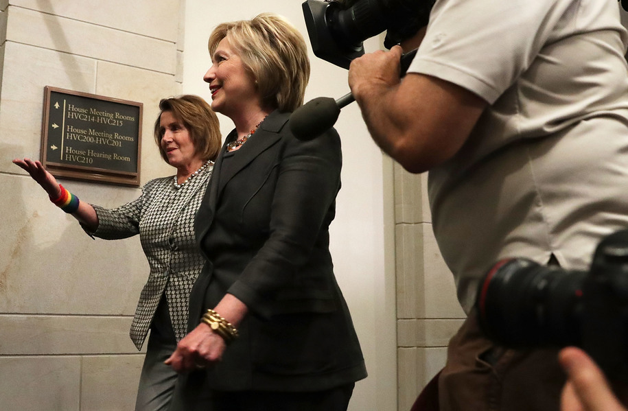 WASHINGTON, DC - JUNE 22: Accompanied by House Minority Leader Rep. Nancy Pelosi (D-CA) (L), Democratic presidential candidate Hillary Clinton arrives to meet with House Democrats June 22, 2016 on Capitol Hill in Washington, DC. Clinton joined the House Democratic Caucus meeting as she continued to campaign for the election. (Photo by Alex Wong/Getty Images)