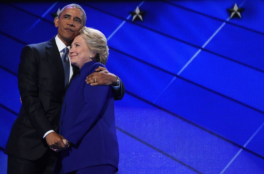TOPSHOT - US President Barack Obama (L) hugs US Presidential nominee Hillary Clinton during the third night of the Democratic National Convention at the Wells Fargo Center in Philadelphia, Pennsylvania, July 27, 2016. / AFP / Robyn BECK        (Photo credit should read ROBYN BECK/AFP/Getty Images)