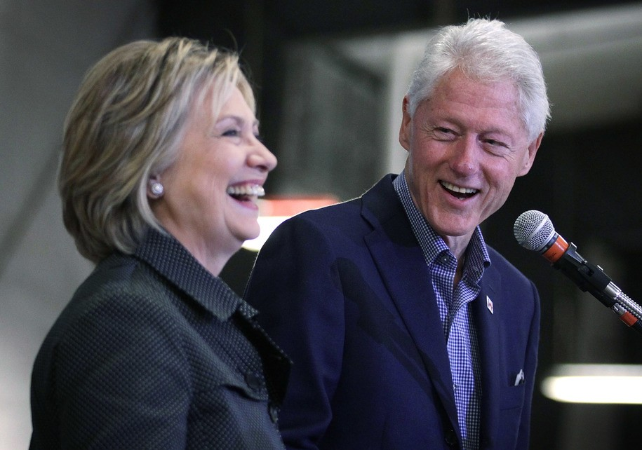 AMES, IA - NOVEMBER 15:  Democratic presidential candidate Hillary Clinton (L) and her husband and former President Bill Clinton share a moment on stage during the Central Iowa Democrats fall barbecue November 15, 2015 at Hansen Agriculture Student Learning Center of Iowa State University in Ames, Iowa. Clinton continued to campaign for the nomination from the Democratic Party.  (Photo by Alex Wong/Getty Images)