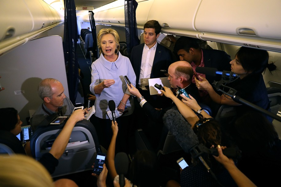 IN FLIGHT - SEPTEMBER 05: Democratic presidential nominee Hillary Clinton speaks to reporters on her campaign plane enroute to Iowa on September 5, 2016. Hillary Clinton is kicking off a Labor Day campaign swing to Ohio and Iowa on a new campaign plane. (Photo by Justin Sullivan/Getty Images)