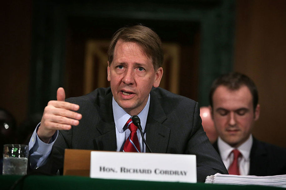 """WASHINGTON, DC - APRIL 07:  Director of the Consumer Financial Protection Bureau Richard Cordray testifies during a hearing before the Senate Banking, Housing and Urban Affairs Committee April 7, 2016 on Capitol Hill in Washington, DC. The committee held a hearing on """"The Consumer Financial Protection Bureau's Semi-Annual Report to Congress.""""  (Photo by Alex Wong/Getty Images)"""