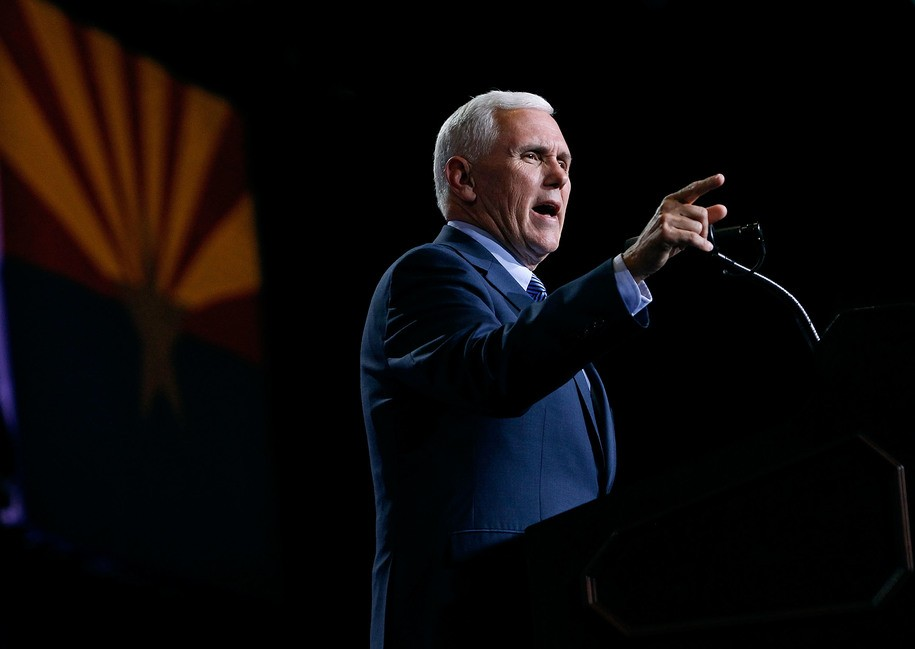 PHOENIX, AZ - AUGUST 31: Republican vice presidential nominee Mike Pence speaks to a crowd of supporters at a campaign rally for presidential nominee Donald Trump on August 31, 2016 in Phoenix, Arizona. Trump detailed a multi-point immigration policy during his speech. (Photo by Ralph Freso/Getty Images)