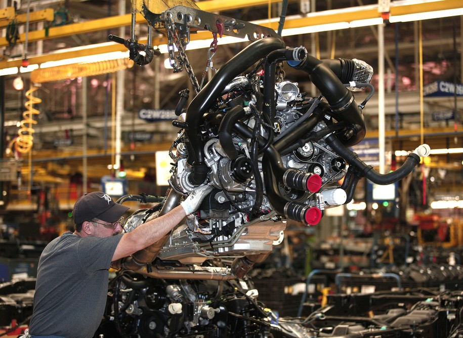 DEARBORN, MI - SEPTEMBER 16: Workers install a Ford EcoBoost engine into a 2014