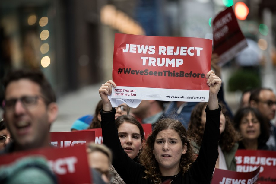 NEW YORK, NEW YORK - SEPTEMBER 29: Protestors and members of a Jewish social action group rally against what they call hateful and violent rhetoric from Republican presidential candidate Donald Trump, outside of Trump Tower on Fifth Avenue, September 29, 2016 in New York City. The protest was organized by Jewish social action group 'Bend the Arc Jewish Action.' (Photo by Drew Angerer/Getty Images)