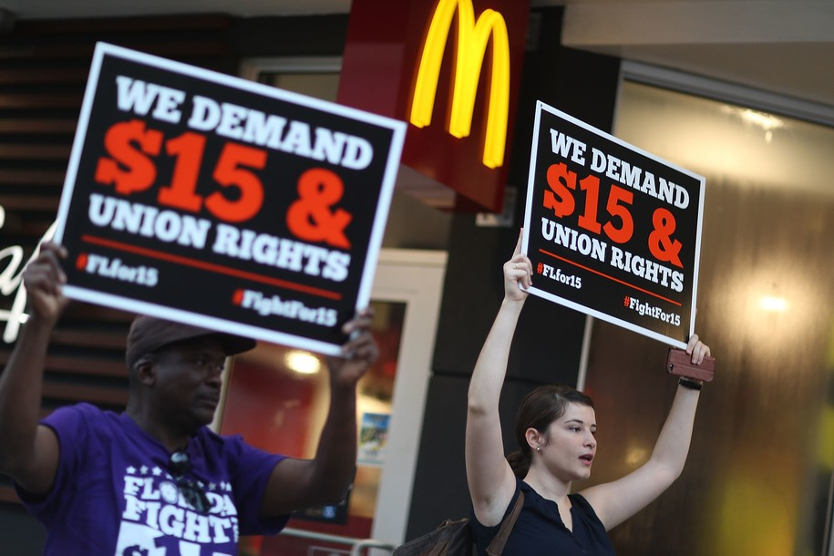 MIAMI, FL - NOVEMBER 10:  Cecelia O'Brien (R) joins other workers to protest outside a McDonald's restaurant on November 10, 2015 in Miami, Florida. The protesters are demanding action from state legislators and presidential candidates to raise the minimum wage to $15 an hour.  (Photo by Joe Raedle/Getty Images)