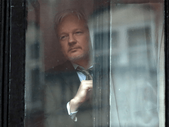 Wikileaks-founder-Julian-Assange-prepares-to-speak-from-the-balcony-of-the-Ecuadorian-embassy-where-he-continues-to-seek-asylum-Getty-640x480.png