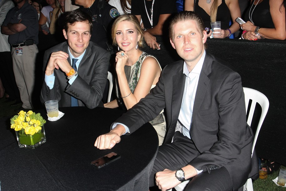 DORAL, FL - MARCH 07: Jared Kushner, Ivanka Trump and Eric Trump attend the Carolina Herrera Fashion Show with GREY GOOSE Vodka at the Cadillac Championship at Trump National Doral on March 7, 2014 in Doral, Florida. (Photo by John Parra/Getty Images for GREY GOOSE)