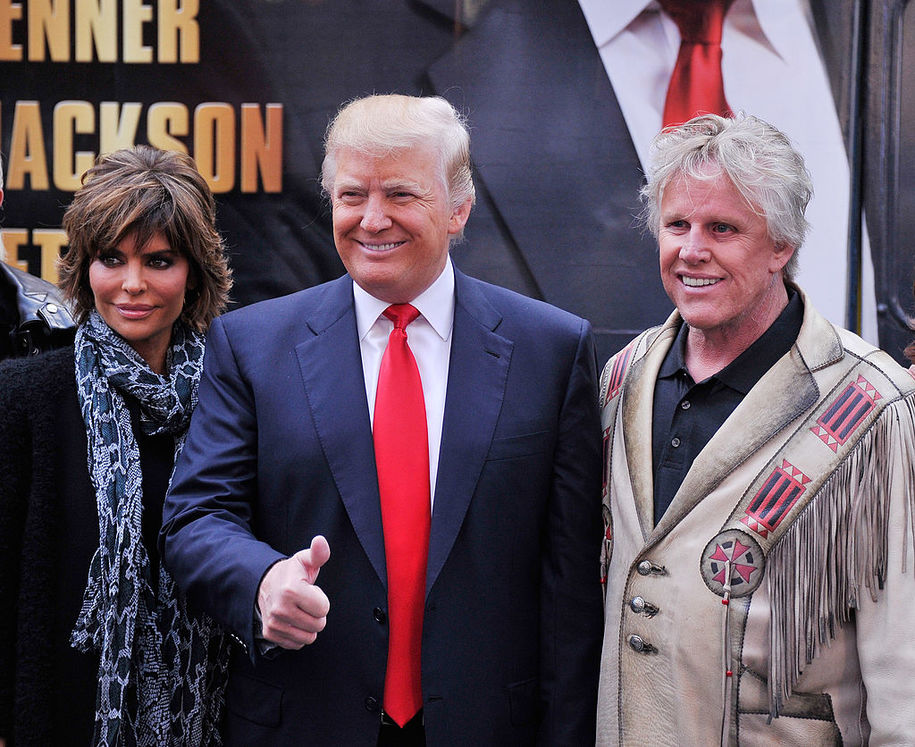 """NEW YORK, NY - OCTOBER 12:  Castmembers actress Lisa Renna businessman/host Donald Trump and actor Gary Busey attend the """"Celebrity Apprentice All Stars"""" Season 13 Bus Tour at  on October 12, 2012 in New York City.  (Photo by Stephen Lovekin/Getty Images)"""
