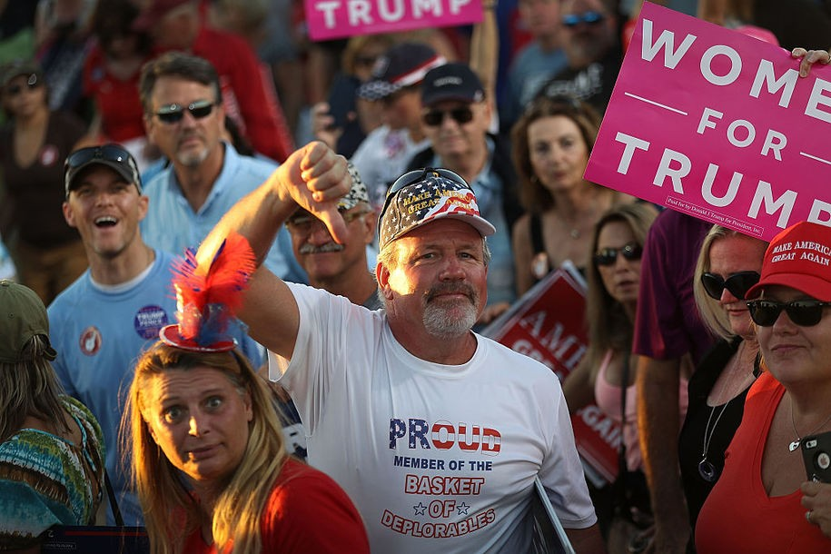 NAPLES, FL - OCTOBER 23:  People gesture to the media as they leave a campaign rally by Republican presidential candidate Donald Trump at the Collier County Fairgrounds on October 23, 2016 in Naples, Florida. Early voting in Florida in the presidential election begins October 24.  (Photo by Joe Raedle/Getty Images)