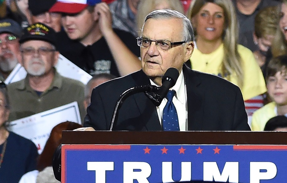 Sheriff Joe Arpaio attends a rally by Republican presidential candidate Donald Trump, October 4, 2016, in Prescott Valley, Arizona..Arpaio will soon face criminal charges from federal prosecutors over his immigration patrols.  Federal prosecutors say they will charge Arpaio with contempt-of-court after he allegedly failed to obey a judges order to halt controversial immigration policies that some say include racial profiling.  / AFP / Robyn Beck        (Photo credit should read ROBYN BECK/AFP/Getty Images)