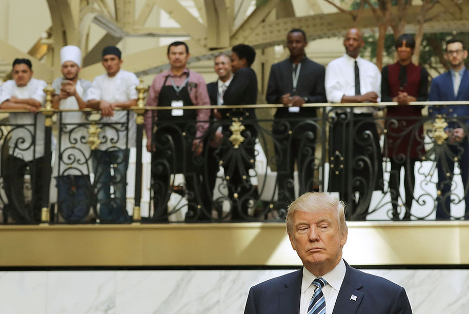 WASHINGTON, DC - OCTOBER 26:  Hotel employees watch Republican presidential nominee Donald Trump following a ribbon cutting ceremony at the new Trump International Hotel October 26, 2016 in Washington, DC. The hotel, built inside the historic Old Post Office, has 263 luxry rooms, including the 6,300-square-foot 'Trump Townhouse' at $100,000 a night, with a five-night minimum. The Trump Organization was granted a 60-year lease to the historic building by the federal government before the billionaire New York real estate mogul announced his intent to run for president.  (Photo by Chip Somodevilla/Getty Images)
