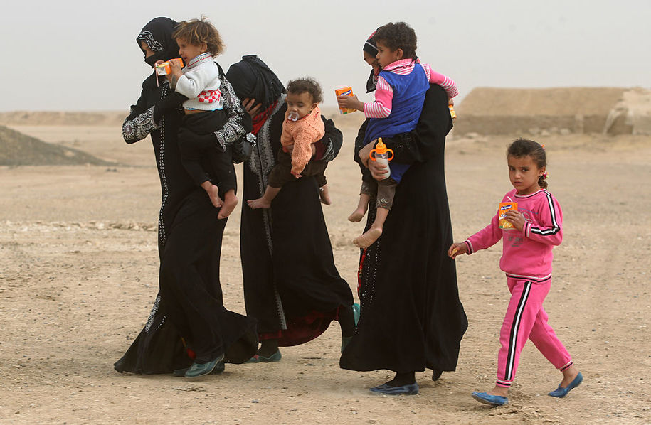 Iraqis who were displaced from the village of Abu Shuwayhah, south of the jihadist-held Mosul, return to their village following the arrival of Iraqi forces on November 1, 2016, as they advance in the ongoing offensive to retake the last major Islamic State (IS) group stronghold in Iraq..Just over two weeks into the massive offensive to retake Mosul soldiers managed to push within city limits... / AFP / AHMAD AL-RUBAYE        (Photo credit should read AHMAD AL-RUBAYE/AFP/Getty Images)