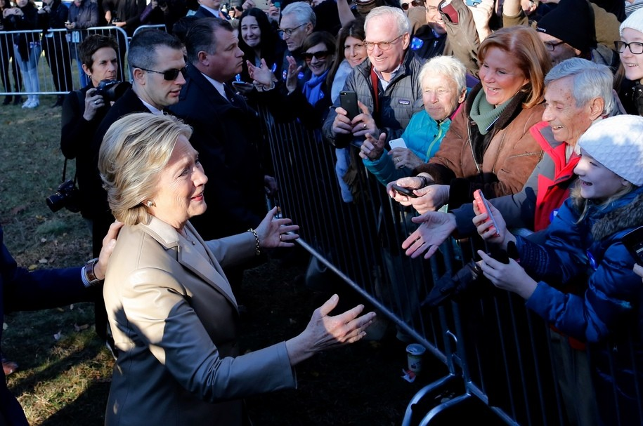 Democratic presidential nominee Hillary Clinton (L) greets supporters after casting her vote in Chappaqua, New York on November 8, 2016..After an exhausting, wild, bitter, and sometimes sordid campaign, Americans finally began voting Tuesday for a new president: either the billionaire populist Donald Trump or Hillary Clinton, seeking to become the first woman to win the White House. / AFP / EDUARDO MUNOZ ALVAREZ        (Photo credit should read EDUARDO MUNOZ ALVAREZ/AFP/Getty Images)