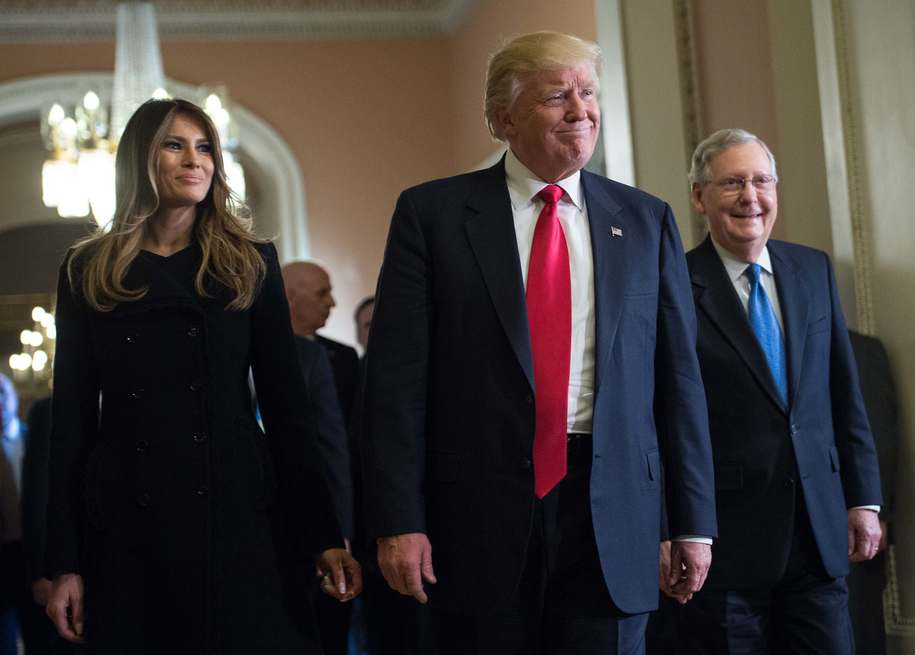 US President-elect Donald Trump and his wife Melania walk with Senate Majority Leader Mitch McConnell (R) following a meeting at the Capitol in Washington, DC, on November 10, 2016. / AFP / NICHOLAS KAMM        (Photo credit should read NICHOLAS KAMM/AFP/Getty Images)