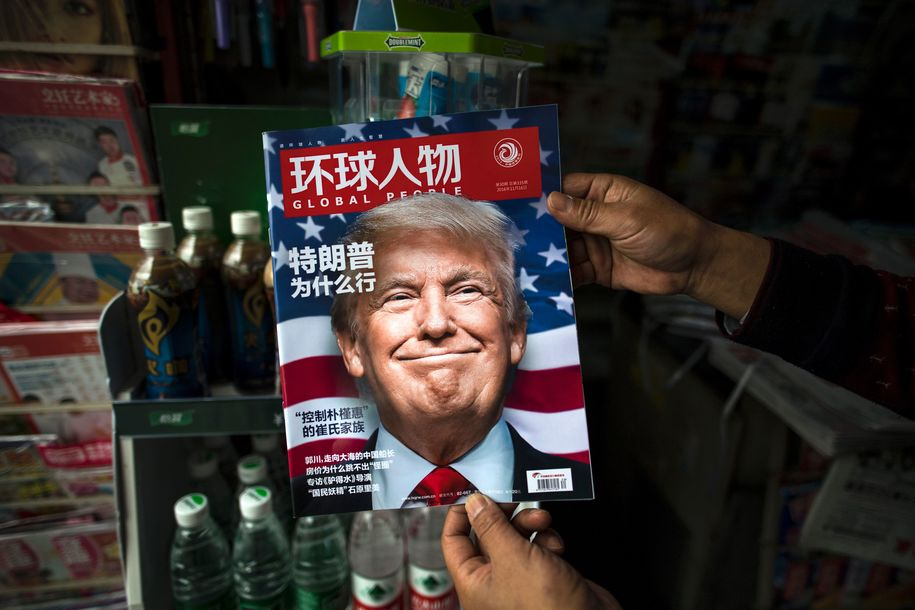 "TOPSHOT - A copy of the local Chinese magazine Global People with a cover story that translates to ""Why did Trump win"" is seen with a front cover portrait of US president-elect Donald Trump at a news stand in Shanghai on November 14, 2016.  .Chinese President Xi Jinping and US president-elect Donald Trump agreed November 14 to meet ""at an early date"" to discuss the relationship between their two powers, Chinese state broadcaster CCTV said.  / AFP / JOHANNES EISELE        (Photo credit should read JOHANNES EISELE/AFP/Getty Images)"