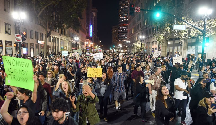 People march and shout during an anti-Trump protest in Oakland, California on November 9, 2016..Thousands of protesters rallied across the United States expressing shock and anger over Donald Trump's election, vowing to oppose divisive views they say helped the Republican billionaire win the presidency. / AFP / Josh Edelson        (Photo credit should read JOSH EDELSON/AFP/Getty Images)