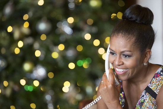 First Lady Michelle Obama reacts while talking on the phone to children across the country as part of the annual NORAD Tracks Santa program. Mrs. Obama answered phone calls from Kailua, Hawaii, Christmas Eve, Dec. 24, 2015. (Official White House Photo by Amanda Lucidon)