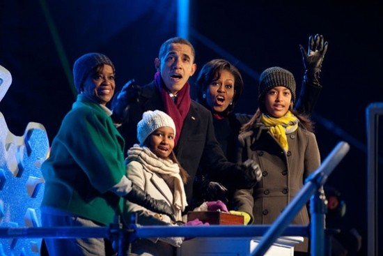 President Barack Obama, daughters Sasha and Malia, First Lady Michelle Obama and Marian Robinson react as they push the button to light the National Christmas Tree during a ceremony on the Ellipse in Washington, D.C., Dec. 9, 2010.