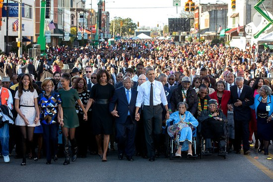 President Barack Obama and First Lady Michelle Obama join hands with Rep. John Lewis, D-Ga. as they lead the walk across the Edmund Pettus Bridge to commemorate the 50th Anniversary of Bloody Sunday and the Selma to Montgomery civil rights marches, in Selma, Ala., March 7, 2015. Malia and Sasha Obama join hands with their grandmother, Marian Robinson.