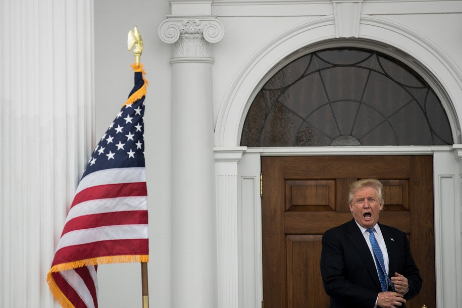 BEDMINSTER TOWNSHIP, NJ - NOVEMBER 20: President-elect Donald Trump responds to a question outside the clubhouse following his meeting with Peter Kirsanow, attorney and member of the U.S. Commission on Civil Rights, at Trump International Golf Club, November 20, 2016 in Bedminster Township, New Jersey. Trump and his transition team are in the process of filling cabinet and other high level positions for the new administration.  (Photo by Drew Angerer/Getty Images)